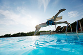 Boy diving into the pool, pool, Las Dunas Playa, Formentera, Balearic Islands, Spain - Stock Image - BHFAT1