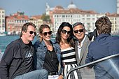 epa04418463 (L-R) US businessman Rande Gerber, compatriot model Cindy Crawford, Lebanese-British lawyer Amal Alamuddin and US actor George Clooney pose for a photographer on a taxi boat in Venice, Italy, 26 September 2014. According to media reports, the wedding of George Clooney and Amal Alamuddin is to take place in Venice this weekend.  EPA/ANDREA MEROLA - Stock Image - E82HX2