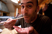 Man Eating with Chopsticks - Stock Image - D5YP5X