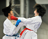Tianjin, China. 21st Nov, 2014. East Asia's Japanese player Miki Kobayashi (R) competes with Mid-Asia's Kazahstan player Zajharova Sabina in the women's 55kg  contest of Karate during the women's group match at the 2nd Asian Championships Cup in Tianjin, north China, on Nov. 21, 2014. The East Asia team claimed the title with 35 points. © Yue Yuewei/Xinhua/Alamy Live News - Stock Image - EAWRDA