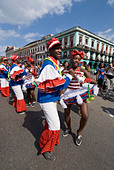 Afrocuban carnival group Los componedores de batea performing in the streets of La Habana Vieja Havana Cuba - Stock Image - B2P2ED