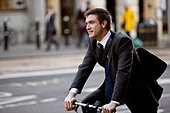 A businessman commuting to work - Stock Image - C2YJMK