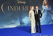 epa04670164 British actress/cast member Lily James (L) with British actor/cast member Richard Madden (R) arrive for the premiere of 'Cinderella' at Leicester Square in London, Britain, 19 March 2015. The film will be released across Britain on 27 March.  EPA/ANDY RAIN - Stock Image - EJ6BPC
