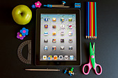Ipad 3 with school accesories on white background - Stock Image - CY69XD