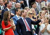 London, UK. 8th July, 2015. Britain's Prince William, Duke of Cambridge (C) gestures next to his wife Catherine, Duchess of Cambridge (L) from his seat in the royal box on center court at the men's singles quarterfinal match between Britain's Andy Murray and Canada's Vasek Pospisil at the 2015 Wimbledon Championships in Wimbledon, southwest London, July 8, 2015. Andy Murray won 3-0. © Han Yan/Xinhua/Alamy Live News - Stock Image - EX7N2A