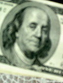 Blurred Closeup of Benjamin Franklin on the Face of a USA One Hundred Dollar $100 Bill - Stock Image - AJXM9N