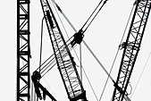 Cranes in silhouette - Stock Image - A3JFCW