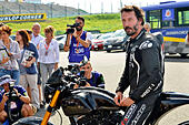 Actor Keanu Reeves test-rides his Arch Motorcycle 'KRGT-1' during the Suzuka 8 Hours FIM Endurance world championship at Suzuka Circuit in Mie prefecture, Japan on July 25, 2015. - Stock Image - EYBJT8