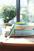 Diet Books And Measuring Tape On Desk - Stock Image - C8WFT0