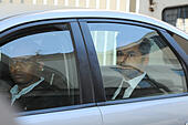Cape Town, South Africa. 6th October, 2014. Shrien Dewani leaves court for the day in police vehicle during Day 1 of the Shrien Dewani trial at the Cape High Court before Judge Jeanette Traverso. Dewani is caused of hiring hit men to murder his wife, Anni. Anni Ninna Dewani (née Hindocha; 12 March 1982 – 13 November 2010) was a Swedish woman who, while on her honeymoon in South Africa, was kidnapped and then murdered in Gugulethu township near Cape Town on 13 November 2010 (wikipedia). © Roger Sedres/Alamy Live News - Stock Image - E8DYYD