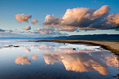 Large clouds reflecting in Lake Tahoe in late afternoon light, California. - Stock Image - C71E75