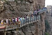 Baoding, China's Hebei Province. 12th July, 2015. Tourists walk on a pavement built with glass on the cliff at Baishishan scenic spot in Laiyuan, north China's Hebei Province, July 12, 2015. The glass pavement, 95-meter-long, has an altitude of 1,900 meters. © Mou Yu/Xinhua/Alamy Live News - Stock Image - EXD7HT