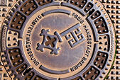 Drain covers with the Bremen key logo. - Stock Image - E6RATT