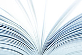 Macro of a open book with pages turning- selective focus - Stock Image - BHCH45