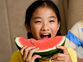 Closeup of girl eating watermelon - Stock Image - BJJ5R3