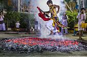 Bangkok, Thailand. 1st Oct, 2014. A man runs through the fire pit during the firewalking ceremony at Wat Yannawa (also spelled Yan Nawa) during the Vegetarian Festival in Bangkok. The Vegetarian Festival is celebrated throughout Thailand. It is the Thai version of the The Nine Emperor Gods Festival, a nine-day Taoist celebration beginning on the eve of 9th lunar month of the Chinese calendar. © ZUMA Press, Inc./Alamy Live News - Stock Image - E8796E