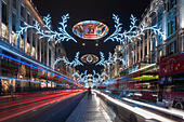 "London, 22 November 2014.  A long exposure produces light trails of passing traffic down Regent Street.  This year's Christmas lights promote the movie ""Night at the Museum 2 - Secret of the Tomb"".  © Stephen Chung/Alamy Live News - Stock Image - EB00YD"