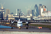 Regional airliner at London City Airport, England, UK - Stock Image - CYHJ7T