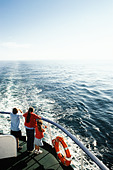Three children on a ferry boat - Stock Image - A46XX4