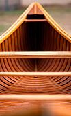 A shot down the length of a cedar canvas strip canoe. - Stock Image - CFCFPY
