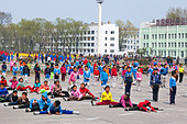 Children practising mass games outside the Grand Theatre, Hamhung, North Korea - Stock Image - D2R4AT