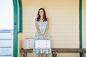 Woman with suitcases waiting for train - Stock Image - CW059X