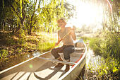 Smiling woman in canoe - Stock Image - E7YW04