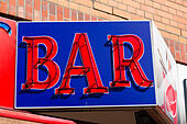 "Neon red on blue ""BAR"" sign, Bremen, Germany - Stock Image - E6W2B9"