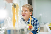 Boy smiling in kitchen - Stock Image - D5WP8E