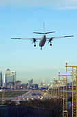Regional airliner Landing at London City Airport, England, UK - Stock Image - CYHJ9E
