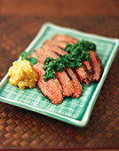 Sliced Steak with Plantain Chutney and Green Chili Cilantro - Stock Image - BJPR72