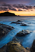 Twilight at Porth Ledden near Land's End, Cornwall , UK - Stock Image - BRAAN3