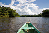 The bow of a dugout canoe on the Arasa River in the Amazon jungle near Manaus Brazil - Stock Image - A5FBYY