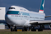 Cathay Pacific Airways Boeing 747-467 taxiing for departure at London Heathrow airport. - Stock Image - B8F1F3