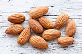 Almonds sitting on a counter top - Stock Image - CNBX1J