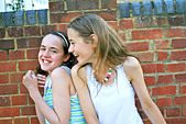 two girls larking around and having fun - Stock Image - BEW06W
