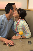 young couple embracing each other in cafe - Stock Image - A3KYR9