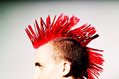 Side view of Punk rocker with red mohican - Stock Image - A9HJ3A