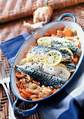 Mackerel in casserole dish with vegetables, close-up - Stock Image - AWMJ8D
