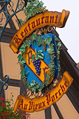 wrought iron sign restaurant au vieux porche dom paul zinck eguisheim alsace france - Stock Image - C0TDRM