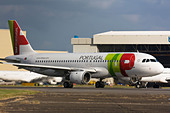 TAP Portugal Airbus A320-211 taxiing for departure at London Heathrow Airport, United Kingdom - Stock Image - B8F1E5
