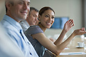 Smiling businesswoman in meeting in conference room - Stock Image - DP1P1B
