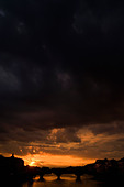 Moody sky at sunset over Florence - Stock Image - AMANJK