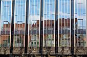 Reflections in the windows of the State Parliament building, showing the historic old buildings of Am Markt, Bremen, Germany. - Stock Image - E6RART