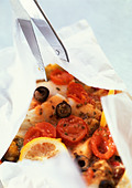 Fish, olives and tomatoes baked en papillote - Stock Image - AWMJ36