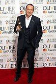 epa04702269 US actor Kevin Spacey poses for a photograph in the winners room of the 39th annual Olivier Awards at The Royal Opera House in London, Britain, 12 April 2015. The theatre awards is named after British actor Laurence Olivier.  EPA/HANNAH MCKAY - Stock Image - EM1YFA