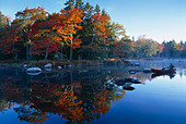 Autumn Mersey River with Canoe nr Kejimkujik National Park Nova Scotia Canada - Stock Image - AB9W83