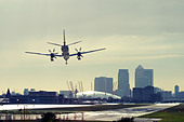 Commercial airplane landing at London City Airport, England, UK. - Stock Image - D5847K