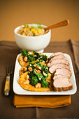 Platter of Pork Tenderloin with Cashew Broccoli - Stock Image - BJMBFN