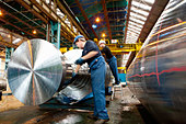 Engineer working on metal machinery - Stock Image - CE9D40